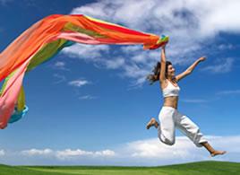 A woman dancing in a field